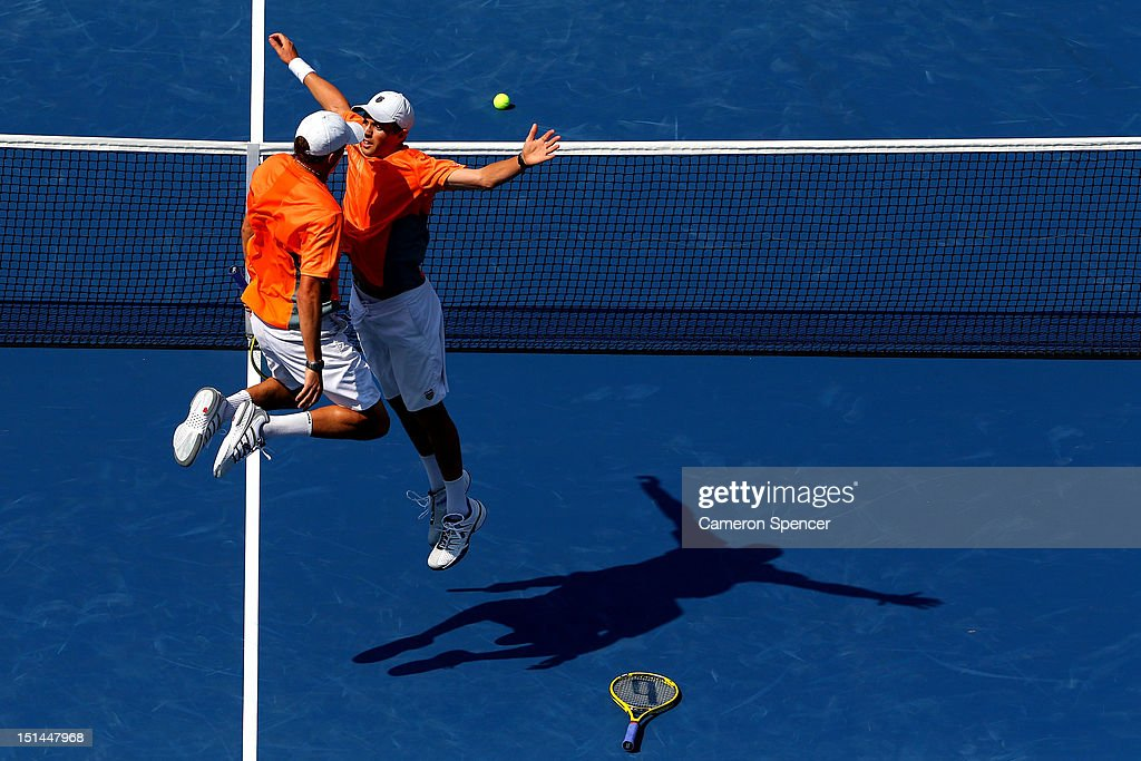 <a gi-track='captionPersonalityLinkClicked' href=/galleries/search?phrase=Bob+Bryan&family=editorial&specificpeople=203335 ng-click='$event.stopPropagation()'>Bob Bryan</a> (L) and <a gi-track='captionPersonalityLinkClicked' href=/galleries/search?phrase=Mike+Bryan&family=editorial&specificpeople=204456 ng-click='$event.stopPropagation()'>Mike Bryan</a> of the United States celebrate match point with a chest bump as <a gi-track='captionPersonalityLinkClicked' href=/galleries/search?phrase=Leander+Paes&family=editorial&specificpeople=215327 ng-click='$event.stopPropagation()'>Leander Paes</a> of India and <a gi-track='captionPersonalityLinkClicked' href=/galleries/search?phrase=Radek+Stepanek&family=editorial&specificpeople=193842 ng-click='$event.stopPropagation()'>Radek Stepanek</a> of the Czech Republic show their dejection after their men's doubles final match on Day Twelve of the 2012 US Open at USTA Billie Jean King National Tennis Center on September 7, 2012 in the Flushing neighborhood of the Queens borough of New York City.