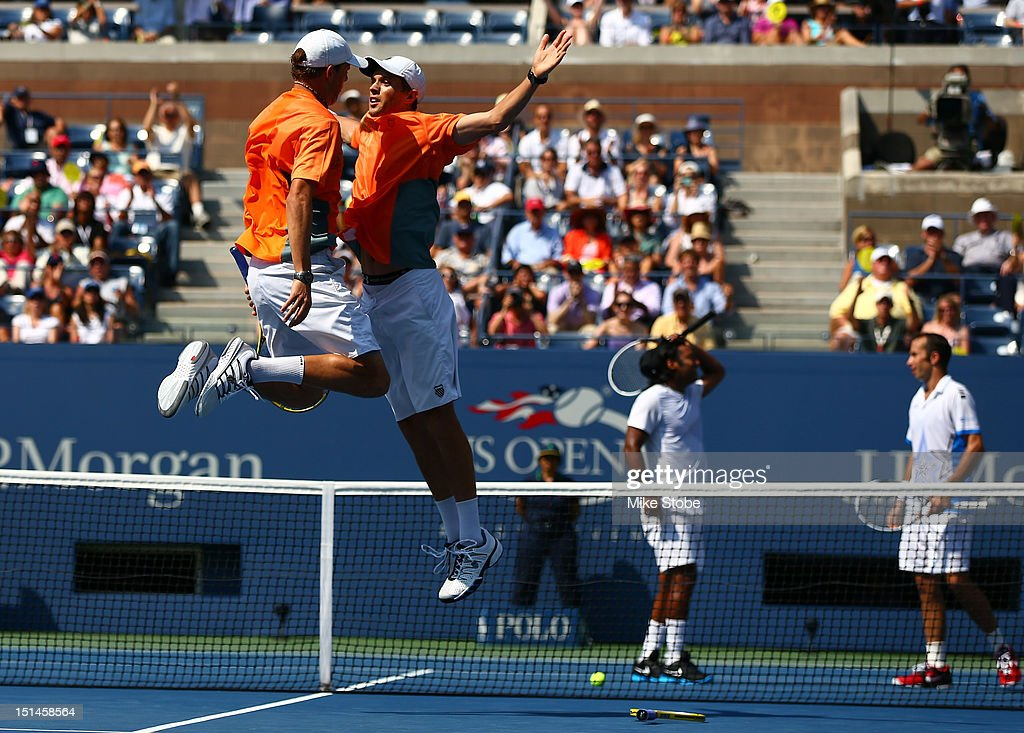 <a gi-track='captionPersonalityLinkClicked' href=/galleries/search?phrase=Bob+Bryan+-+Tennis+Player&family=editorial&specificpeople=203335 ng-click='$event.stopPropagation()'>Bob Bryan</a> (L) and <a gi-track='captionPersonalityLinkClicked' href=/galleries/search?phrase=Mike+Bryan+-+Tennis+Player&family=editorial&specificpeople=204456 ng-click='$event.stopPropagation()'>Mike Bryan</a> (2nd R) of the United States celebrate match point with a chest bump as <a gi-track='captionPersonalityLinkClicked' href=/galleries/search?phrase=Leander+Paes&family=editorial&specificpeople=215327 ng-click='$event.stopPropagation()'>Leander Paes</a> (2nd R) of India and <a gi-track='captionPersonalityLinkClicked' href=/galleries/search?phrase=Radek+Stepanek&family=editorial&specificpeople=193842 ng-click='$event.stopPropagation()'>Radek Stepanek</a> (R) of the Czech Repulic react during their men's doubles final match on Day Twelve of the 2012 U.S. Open at the USTA Billie Jean King National Tennis Center on September 7, 2012 in the Flushing neighborhood, of the Queens borough of New York City.