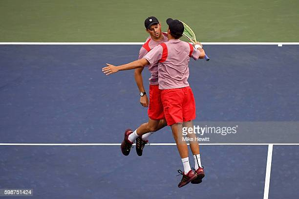 Bob Bryan and Mike Bryan of the United States celebrate their victory over Jonathan Erlich of Israel and Sam Groth of Australia Santiago Gonzalez of...