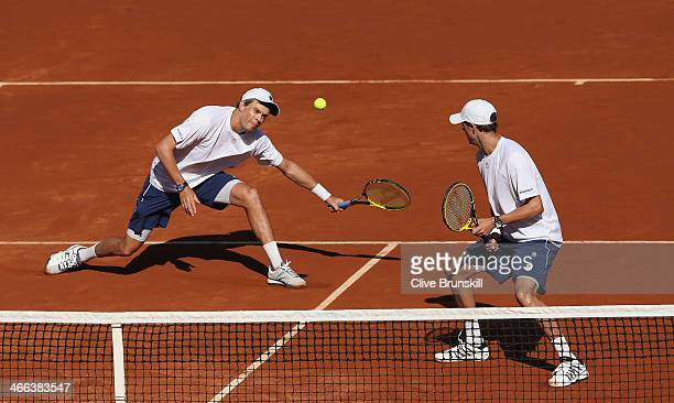 Bob Bryan and Mike Bryan of the United States in action against Colin Fleming and Dominic Inglot of Great Britain in their doubles match during day...