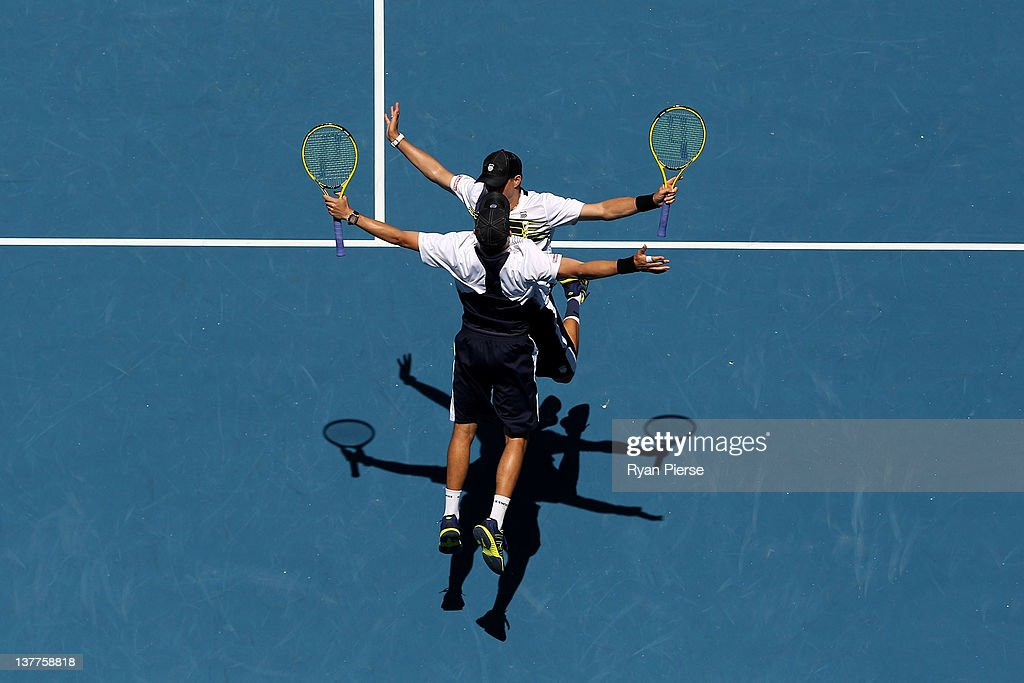 <a gi-track='captionPersonalityLinkClicked' href=/galleries/search?phrase=Bob+Bryan+-+Tennis+Player&family=editorial&specificpeople=203335 ng-click='$event.stopPropagation()'>Bob Bryan</a> and <a gi-track='captionPersonalityLinkClicked' href=/galleries/search?phrase=Mike+Bryan+-+Tennis+Player&family=editorial&specificpeople=204456 ng-click='$event.stopPropagation()'>Mike Bryan</a> of the United States of America chest bump in celebration of winning their doubles semifinal match against Horia Tecau of Romania and Robert Lindstedt of Sweden during day eleven of the 2012 Australian Open at Melbourne Park on January 26, 2012 in Melbourne, Australia.
