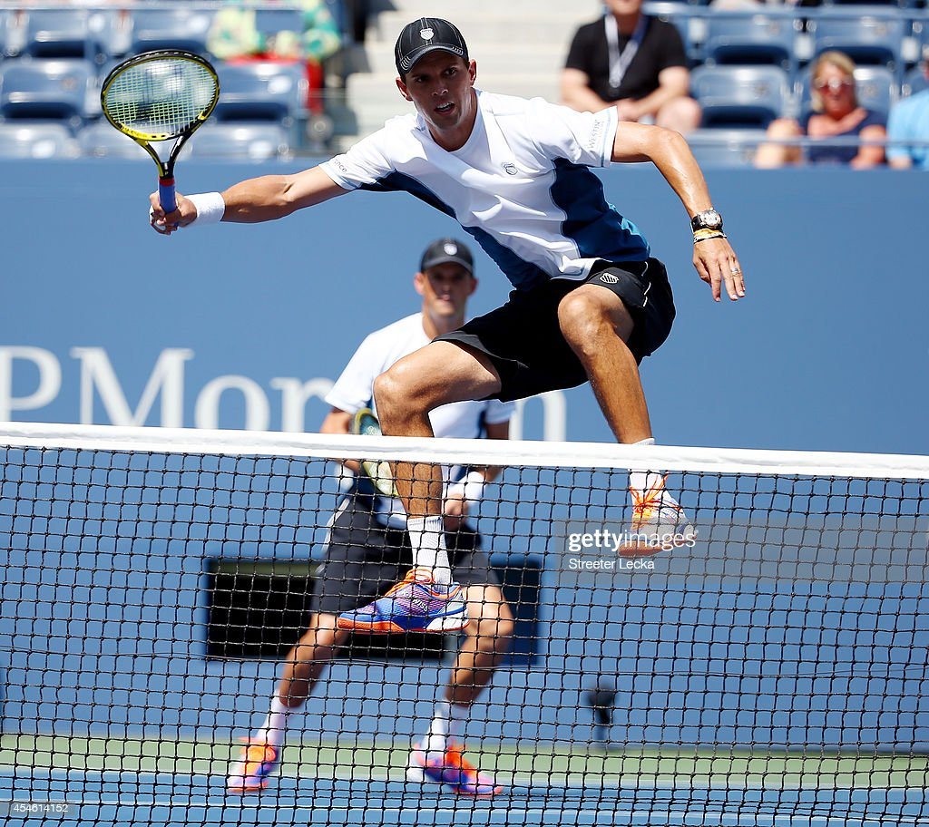 <a gi-track='captionPersonalityLinkClicked' href=/galleries/search?phrase=Bob+Bryan&family=editorial&specificpeople=203335 ng-click='$event.stopPropagation()'>Bob Bryan</a> and <a gi-track='captionPersonalityLinkClicked' href=/galleries/search?phrase=Mike+Bryan&family=editorial&specificpeople=204456 ng-click='$event.stopPropagation()'>Mike Bryan</a> of the United States play against Scott Lipsky and Rajeev Ram of the United States during their men's doubles semifinal match on Day Eleven of the 2014 US Open at the USTA Billie Jean King National Tennis Center on September 3, 2014 in the Flushing neighborhood of the Queens borough of New York City.