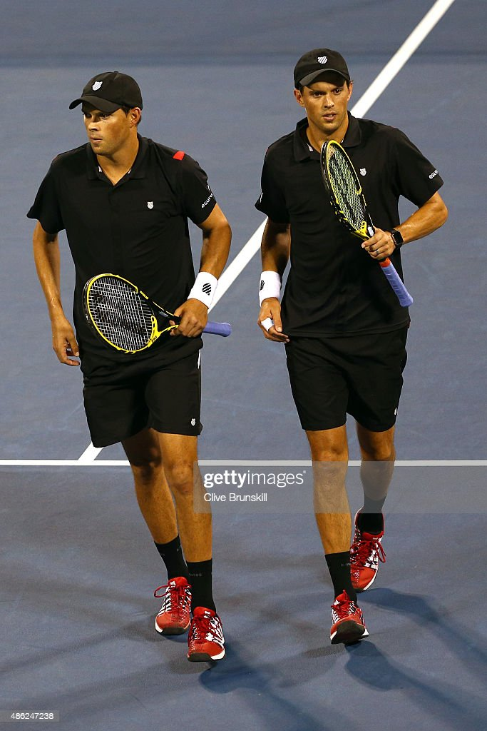 <a gi-track='captionPersonalityLinkClicked' href=/galleries/search?phrase=Bob+Bryan&family=editorial&specificpeople=203335 ng-click='$event.stopPropagation()'>Bob Bryan</a> and <a gi-track='captionPersonalityLinkClicked' href=/galleries/search?phrase=Mike+Bryan&family=editorial&specificpeople=204456 ng-click='$event.stopPropagation()'>Mike Bryan</a> of the United States play against Steve Johnson and Sam Querrey of the United States in their Men's Doubles First Round match on Day Three of the 2015 US Open at the USTA Billie Jean King National Tennis Center on September 2, 2015 in the Flushing neighborhood of the Queens borough of New York City.