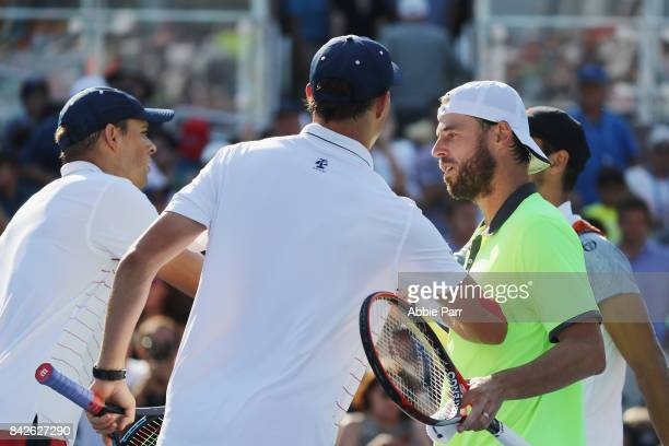 Bob Bryan and Mike Bryan of the United States shake hands with Oliver Marach of Austria and Mate Pavic of Croatia after their third round Men's...