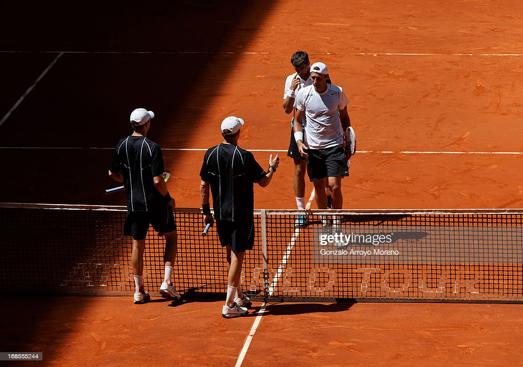 <a gi-track='captionPersonalityLinkClicked' href=/galleries/search?phrase=Bob+Bryan&family=editorial&specificpeople=203335 ng-click='$event.stopPropagation()'>Bob Bryan</a> and <a gi-track='captionPersonalityLinkClicked' href=/galleries/search?phrase=Mike+Bryan&family=editorial&specificpeople=204456 ng-click='$event.stopPropagation()'>Mike Bryan</a> of the US greet <a gi-track='captionPersonalityLinkClicked' href=/galleries/search?phrase=Jeremy+Chardy&family=editorial&specificpeople=599085 ng-click='$event.stopPropagation()'>Jeremy Chardy</a> of France and <a gi-track='captionPersonalityLinkClicked' href=/galleries/search?phrase=Lukasz+Kubot&family=editorial&specificpeople=835499 ng-click='$event.stopPropagation()'>Lukasz Kubot</a> of Poland after winning their semi-final doubles match on day eight of the Mutua Madrid Open tennis tournament at the Caja Magica on May 11, 2013 in Madrid, Spain.
