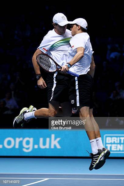 Bob Bryan and Mike Bryan of the USA celebrate after winning their men's doubles match against Lukas Dlouhy of Czech Republic and Leander Paes of...