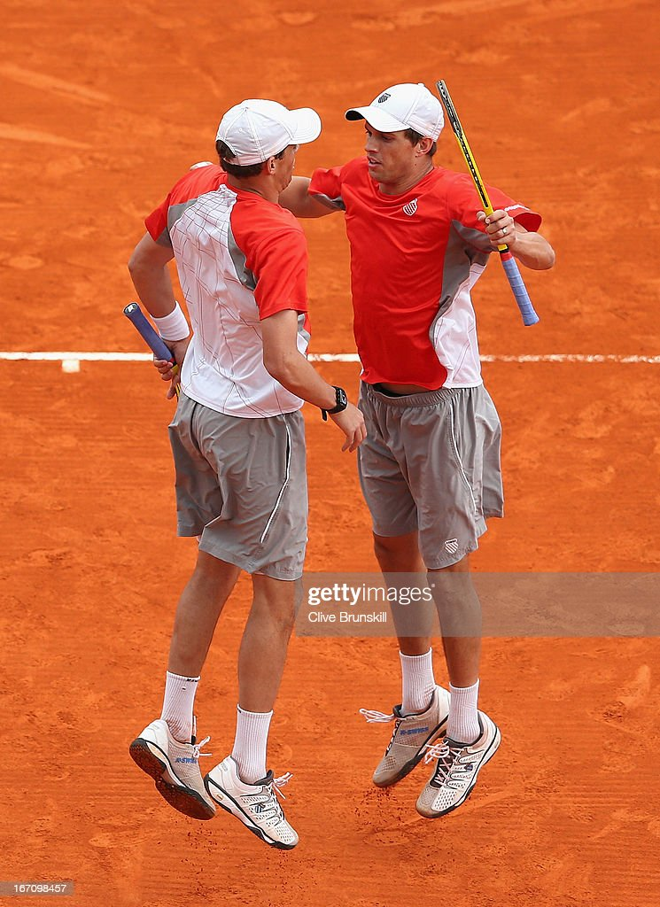 <a gi-track='captionPersonalityLinkClicked' href=/galleries/search?phrase=Bob+Bryan+-+Tennis+Player&family=editorial&specificpeople=203335 ng-click='$event.stopPropagation()'>Bob Bryan</a> and <a gi-track='captionPersonalityLinkClicked' href=/galleries/search?phrase=Mike+Bryan+-+Tennis+Player&family=editorial&specificpeople=204456 ng-click='$event.stopPropagation()'>Mike Bryan</a> of the USA celebrate match point against Milos Raonic of Canada and Bernard Tomic of Australia in their doubles semi final match during day seven of the ATP Monte Carlo Masters,at Monte-Carlo Sporting Club on April 20, 2013 in Monte-Carlo, Monaco.