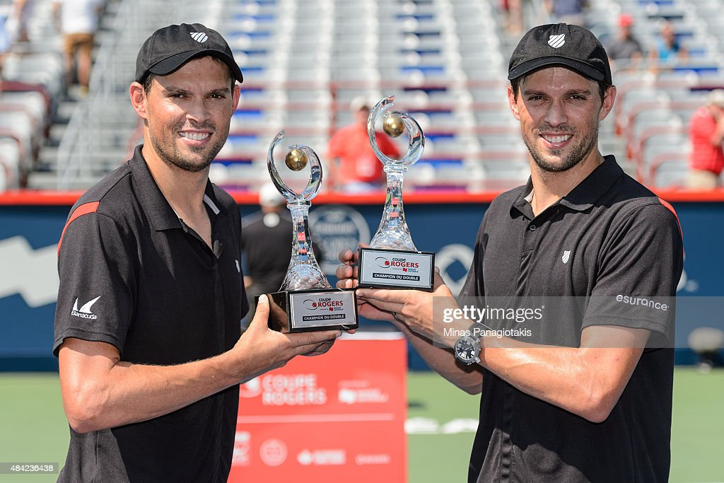 Bob Bryan and Mike Bryan of the USA hold up their Rogers Cup Doubles Championship trophies after defeating Daniel Nestor of Canada and Edouard Roger-Vasselin of France 7-6, 3-6, 10-6 during day seven of the Rogers Cup at Uniprix Stadium on August 16, 2015 in Montreal, Quebec, Canada.