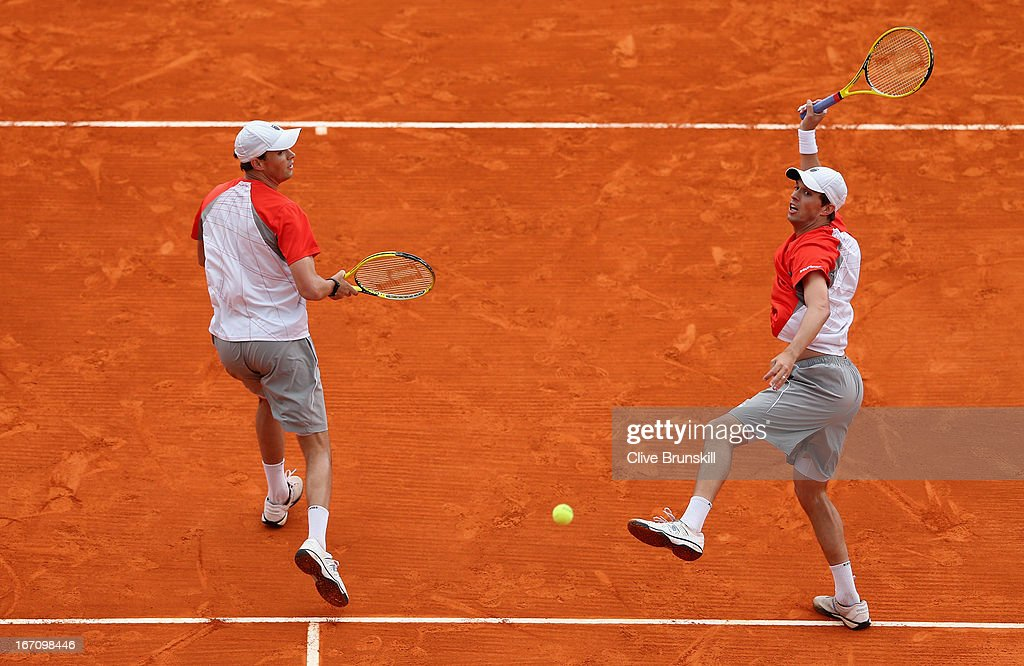 <a gi-track='captionPersonalityLinkClicked' href=/galleries/search?phrase=Bob+Bryan+-+Tennis+Player&family=editorial&specificpeople=203335 ng-click='$event.stopPropagation()'>Bob Bryan</a> and <a gi-track='captionPersonalityLinkClicked' href=/galleries/search?phrase=Mike+Bryan+-+Tennis+Player&family=editorial&specificpeople=204456 ng-click='$event.stopPropagation()'>Mike Bryan</a> of the USA in action against Milos Raonic of Canada and Bernard Tomic of Australia in their doubles semi final match during day seven of the ATP Monte Carlo Masters,at Monte-Carlo Sporting Club on April 20, 2013 in Monte-Carlo, Monaco.