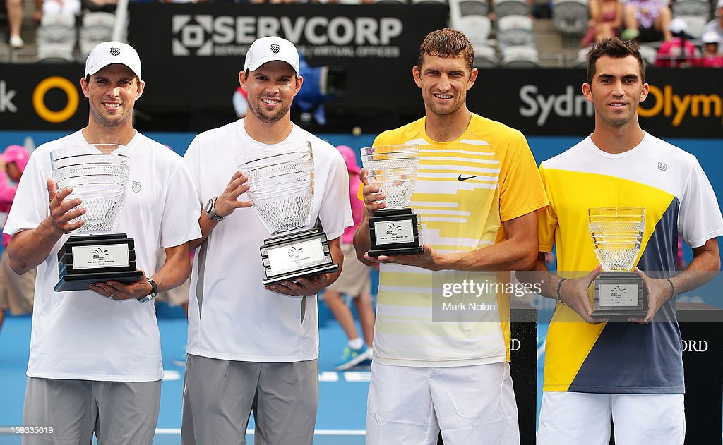 Bob Bryan and Mike Bryan of the USA, Max Mirnyi of Belarus Horia Tecau of Romania pose for photos after the Mens doubles final during day seven of the Sydney International at Sydney Olympic Park Tennis Centre on January 12, 2013 in Sydney, Australia.