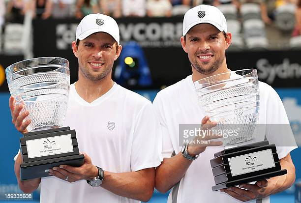 Bob Bryan and Mike Bryan of the USA pose for photos after winning the Mens doubles final against Max Mirnyi of Belarus and Horia Tecau of Romania...