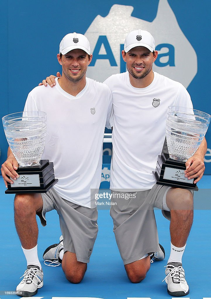 Bob Bryan and Mike Bryan of the USA pose for photos after winning the Mens doubles final against Max Mirnyi of Belarus and Horia Tecau of Romania during day seven of the Sydney International at Sydney Olympic Park Tennis Centre on January 12, 2013 in Sydney, Australia.