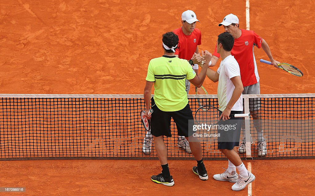 Bob Bryan and Mike Bryan of the USA shake hands at the net after their straight sets victory against Milos Raonic of Canada and Bernard Tomic of Australia in their doubles semi final match during day seven of the ATP Monte Carlo Masters,at Monte-Carlo Sporting Club on April 20, 2013 in Monte-Carlo, Monaco.
