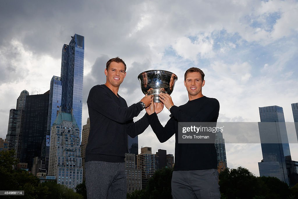<a gi-track='captionPersonalityLinkClicked' href=/galleries/search?phrase=Bob+Bryan+-+Tennis+Player&family=editorial&specificpeople=203335 ng-click='$event.stopPropagation()'>Bob Bryan</a> and (R) <a gi-track='captionPersonalityLinkClicked' href=/galleries/search?phrase=Mike+Bryan+-+Tennis+Player&family=editorial&specificpeople=204456 ng-click='$event.stopPropagation()'>Mike Bryan</a> of United States pose with the US Open men's doubles champions trophy in Central Park during their New York City media tour after winning their 100th career title on September 8, 2014 in New York City.