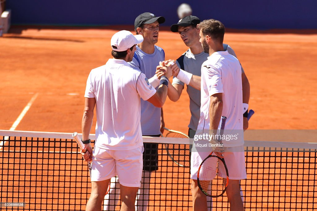 Bob Bryan and Mike Bryan of United States with Pablo Cuevas of Urugay and Marcel Granollers of Spain shake hands after the doubles final match during...