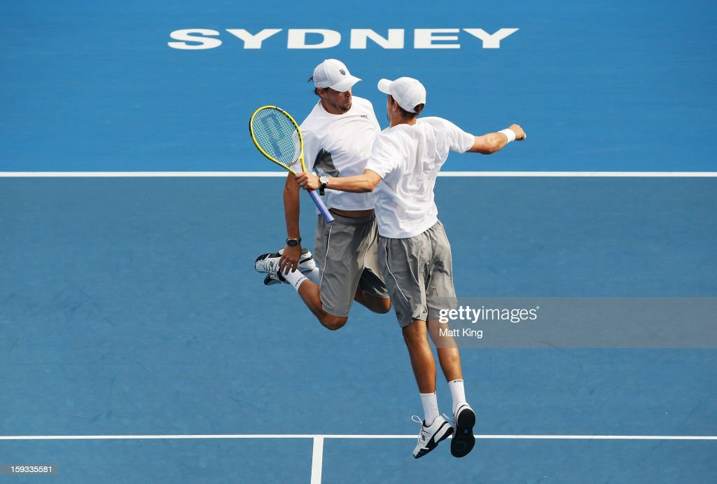 <a gi-track='captionPersonalityLinkClicked' href=/galleries/search?phrase=Bob+Bryan+-+Tennis+Player&family=editorial&specificpeople=203335 ng-click='$event.stopPropagation()'>Bob Bryan</a> (L) and <a gi-track='captionPersonalityLinkClicked' href=/galleries/search?phrase=Mike+Bryan+-+Tennis+Player&family=editorial&specificpeople=204456 ng-click='$event.stopPropagation()'>Mike Bryan</a> (R) of USA celebrate after winning match point against Max Mirnyi of Belarus and Horia Tecau of Romania during day seven of the Sydney International at Sydney Olympic Park Tennis Centre on January 12, 2013 in Sydney, Australia.