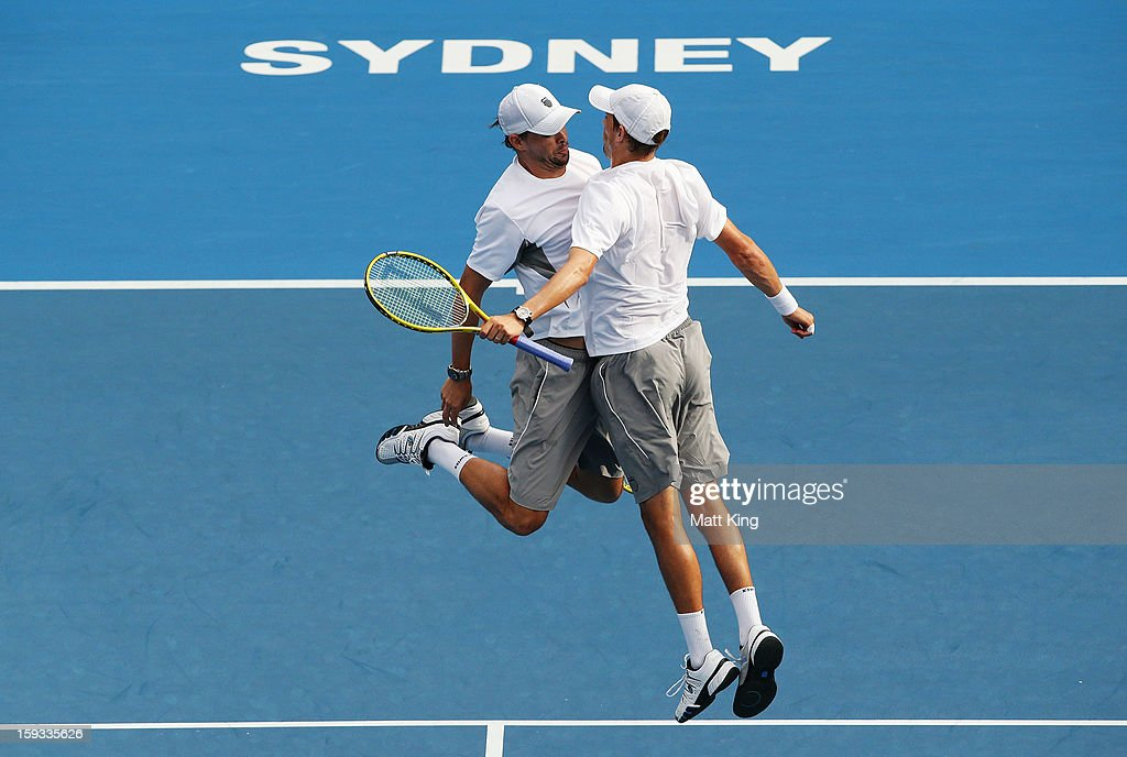 Bob Bryan (L) and Mike Bryan (R) of USA celebrate after winning match point against Max Mirnyi of Belarus and Horia Tecau of Romania during day seven of the Sydney International at Sydney Olympic Park Tennis Centre on January 12, 2013 in Sydney, Australia.