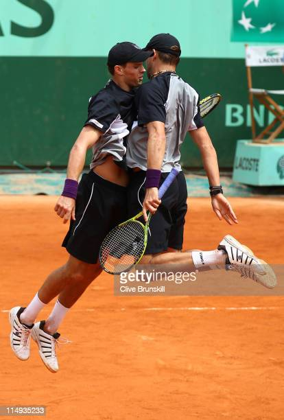 Bob Bryan and Mike Bryan of USA celebrate matchpoint during the men's doubles round three match between Bob Bryan and Mike Bryan of USA and Teymuraz...