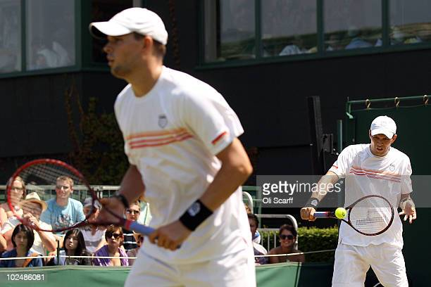 Bob Bryan and Mike Bryan of USA in action against Colin Fleming and Kenneth Skupski of Great Britain on Day Seven of the Wimbledon Lawn Tennis...