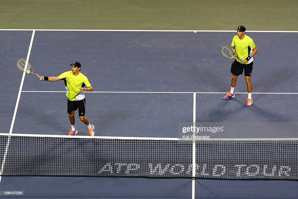 <a gi-track='captionPersonalityLinkClicked' href=/galleries/search?phrase=Bob+Bryan&family=editorial&specificpeople=203335 ng-click='$event.stopPropagation()'>Bob Bryan</a> and <a gi-track='captionPersonalityLinkClicked' href=/galleries/search?phrase=Mike+Bryan&family=editorial&specificpeople=204456 ng-click='$event.stopPropagation()'>Mike Bryan</a> of USA in action during the men's doubles first round match against Pierre-Hugues Herbert of France and Michal Przysiezny of Poland on day three of Rakuten Open 2014 at Ariake Colosseum on October 1, 2014 in Tokyo, Japan.