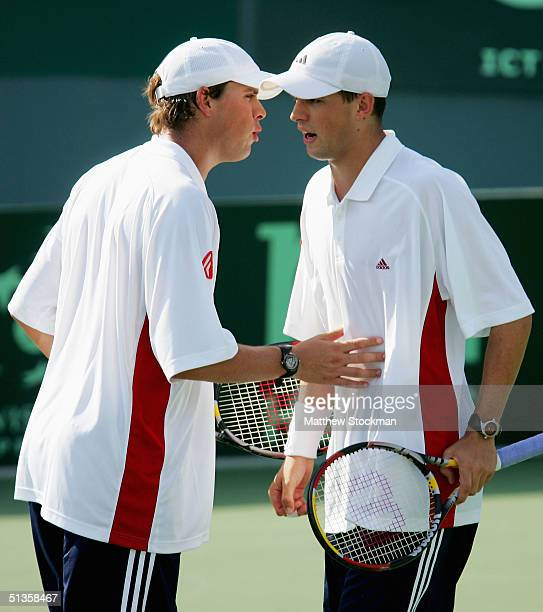 Bob Bryan confers with his brother Mike while playing Max Mirnyi and Vladimir Voltchkov of Belarus during the semifinals of the Davis Cup on...