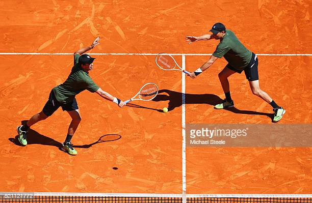 Bob Bryan of the United States and Mike Bryan of the United States in action during the round two doubles match against Juan Sebastian Cabal of...