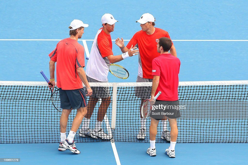Bob Bryan of the United States and Mike Bryan of the United States shake hands at the net with Flavio Cipolla of Italy and Andreas Seppi of Italy after winning their men's second round doubles match during day five of the 2013 Australian Open at Melbourne Park on January 18, 2013 in Melbourne, Australia.