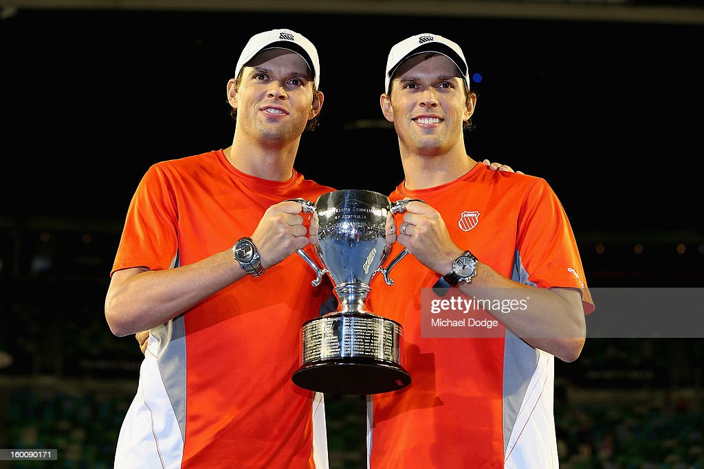 Bob Bryan of the United States and Mike Bryan of the United States celebrate with the championship trophy after winning their doubles final match against Robin Haase of the Netherlands and Igor Sijsling of the Netherlands during day thirteen of the 2013 Australian Open at Melbourne Park on January 26, 2013 in Melbourne, Australia.