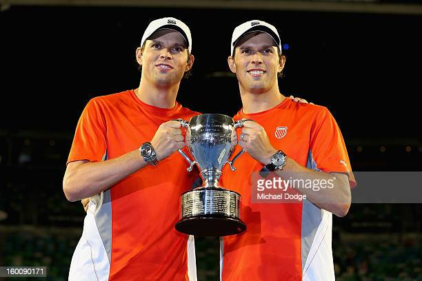 Bob Bryan of the United States and Mike Bryan of the United States celebrate with the championship trophy after winning their doubles final match...