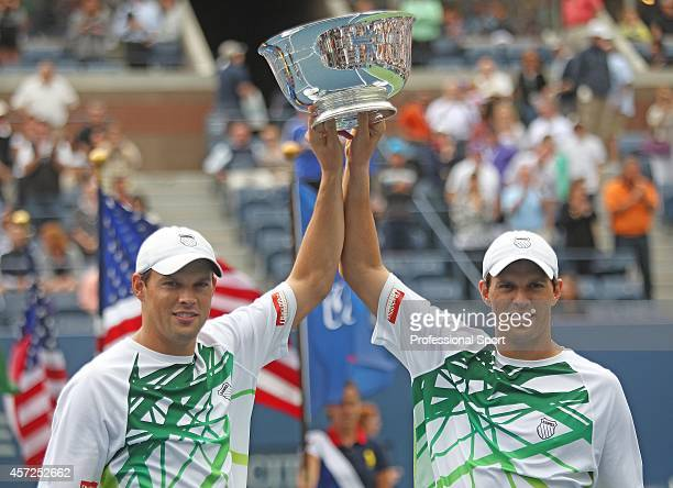 Bob Bryan of the United States and Mike Bryan of the United States hold the championship trophy after defeating Rohan Bopanna of India and AisamUlHaq...