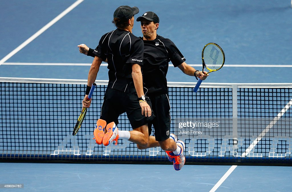 Bob Bryan of the United States and Mike Bryan of the United States celebrate match point in the doubles semi-final match against Julien Benneteau of France and Edouard Roger-Vasselin of France on day seven of the Barclays ATP World Tour Finals at O2 Arena on November 15, 2014 in London, England.