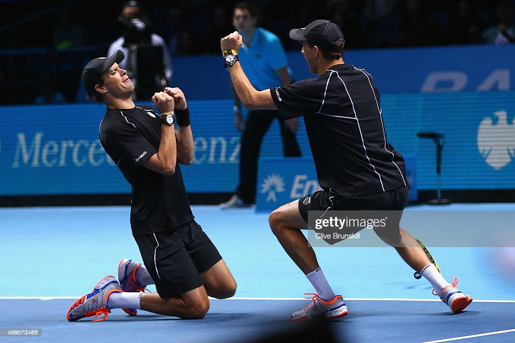 <a gi-track='captionPersonalityLinkClicked' href=/galleries/search?phrase=Bob+Bryan+-+Tennis+Player&family=editorial&specificpeople=203335 ng-click='$event.stopPropagation()'>Bob Bryan</a> of the United States and <a gi-track='captionPersonalityLinkClicked' href=/galleries/search?phrase=Mike+Bryan+-+Tennis+Player&family=editorial&specificpeople=204456 ng-click='$event.stopPropagation()'>Mike Bryan</a> of the United States celebrate match point in the doubles final match against Ivan Dodig of Croatia and Marcelo Melo of Brazil on day eight of the Barclays ATP World Tour Finals at O2 Arena on November 16, 2014 in London, England.