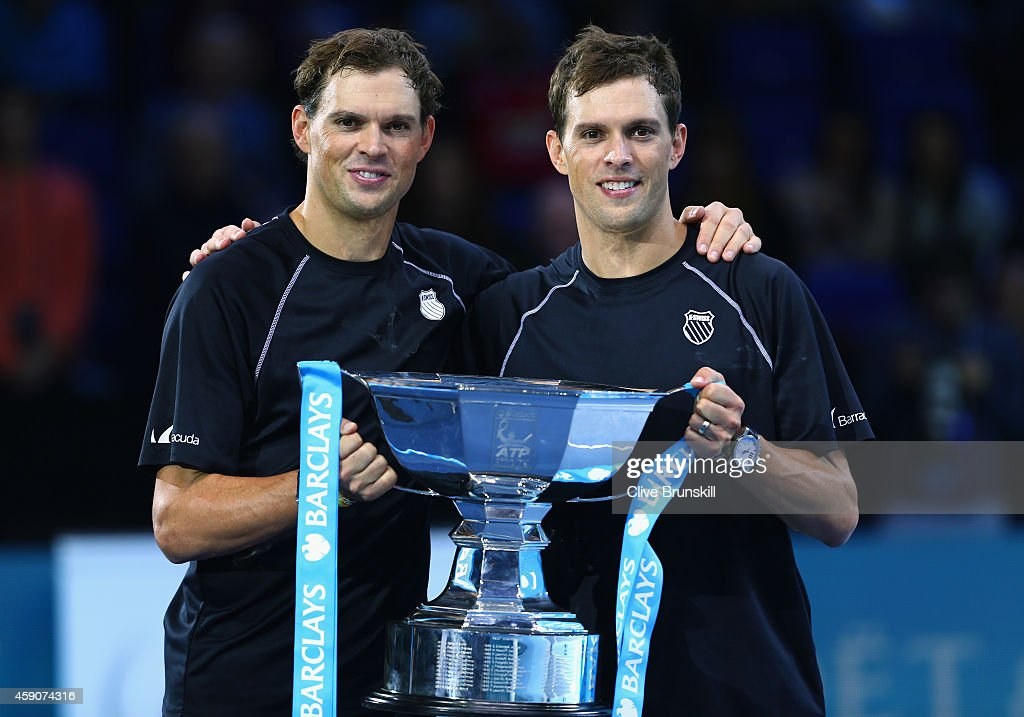 <a gi-track='captionPersonalityLinkClicked' href=/galleries/search?phrase=Bob+Bryan&family=editorial&specificpeople=203335 ng-click='$event.stopPropagation()'>Bob Bryan</a> of the United States and <a gi-track='captionPersonalityLinkClicked' href=/galleries/search?phrase=Mike+Bryan&family=editorial&specificpeople=204456 ng-click='$event.stopPropagation()'>Mike Bryan</a> of the United States lift the ATP Doubles Trophy after the doubles final match against Ivan Dodig of Croatia and Marcelo Melo of Brazil on day eight of the Barclays ATP World Tour Finals at O2 Arena on November 16, 2014 in London, England.