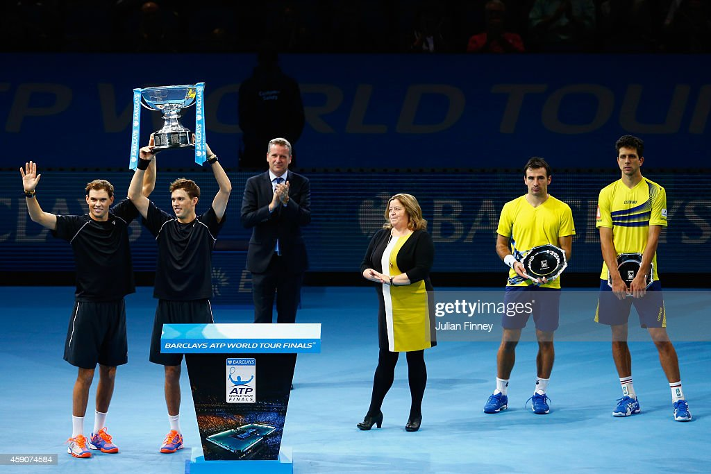 Bob Bryan of the United States and Mike Bryan of the United States lift the ATP Doubles Trophy after the doubles final match against Ivan Dodig of Croatia and Marcelo Melo of Brazil on day eight of the Barclays ATP World Tour Finals at O2 Arena on November 16, 2014 in London, England.