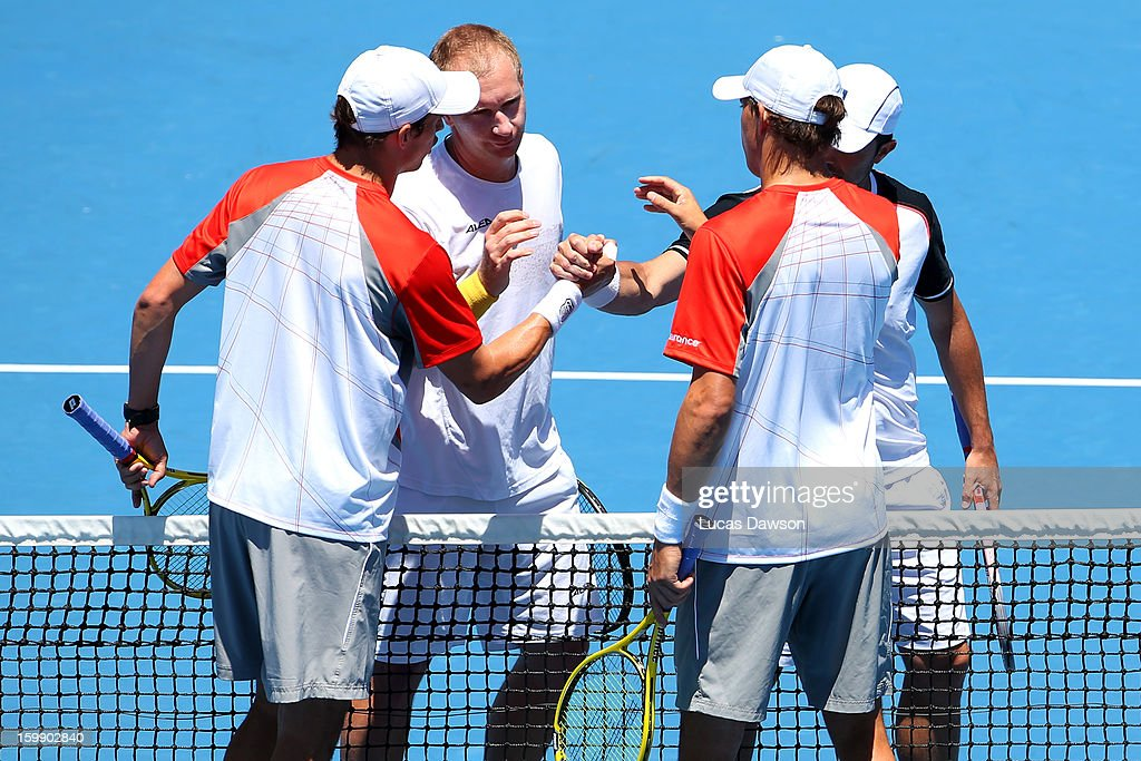 Bob Bryan of the United States Mike Bryan of the United States shake hands with Daniele Bracciali of Italy and Lukas Dlouhy of the Czech Republic...