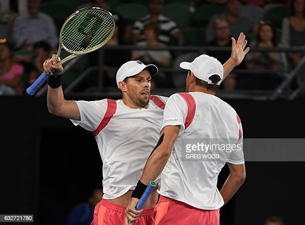 Bob Bryan of the US and Mike Bryan of the US 'chest bump' to celebrate their victory over Pablo Carreno Busta of Spain and Guillermo GarciaLopez of...