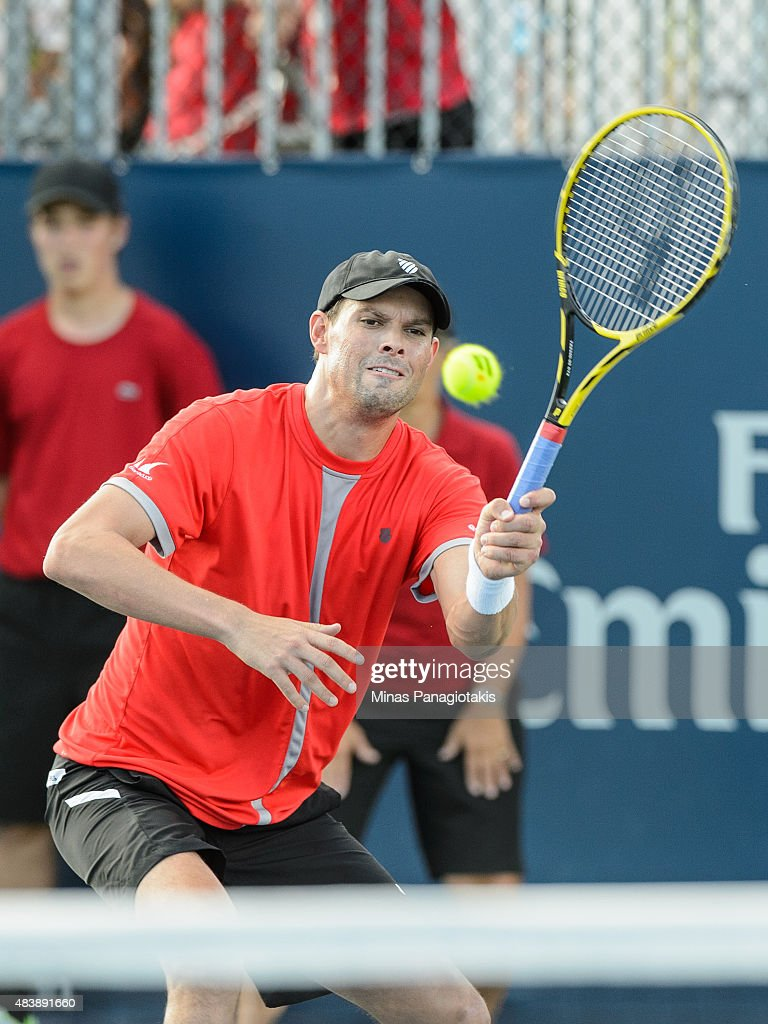 Bob Bryan of the USA hits a return against Feliciano Lopez of Spain and Max Mirnyi of Belarus during day four of the Rogers Cup at Uniprix Stadium on...