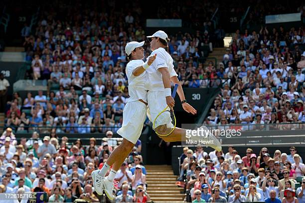 Bob Bryan of USA and Mike Bryan of USA chest bump following their victory during the Gentlemen's Doubles semi final match against Rohan Bopanna of...