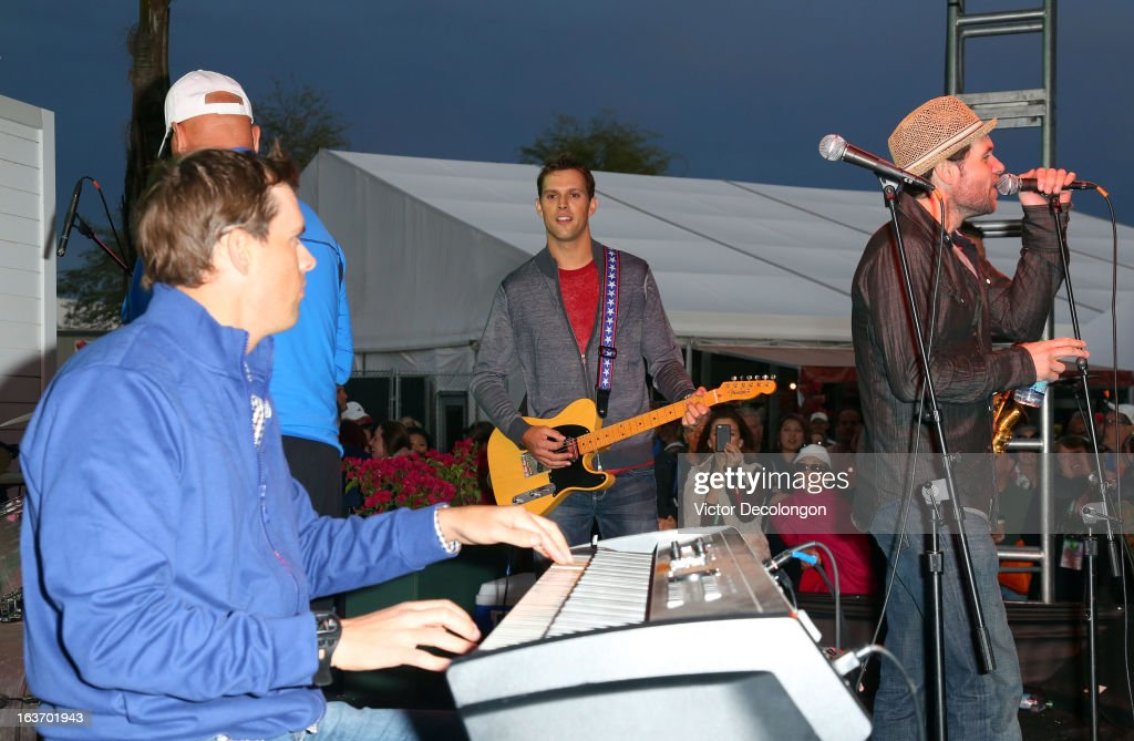 Bob Bryan plays the keyboard as brother Mike Bryan plays the guitar during a concert at Indian Wells Tennis Garden on March 7, 2013 in Indian Wells, California.