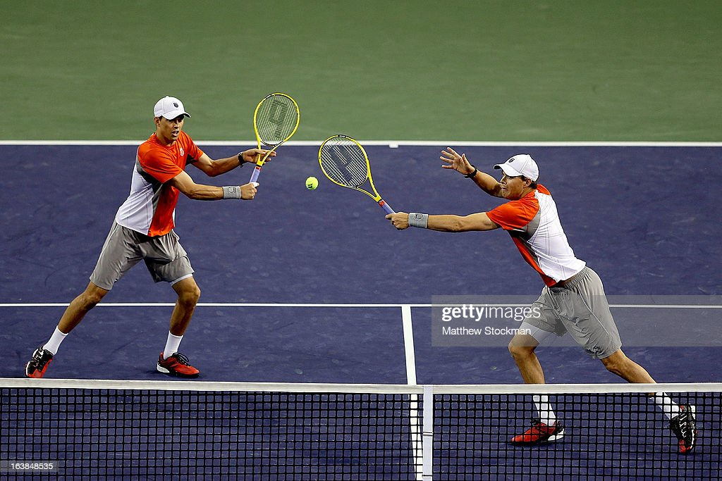 Bob Bryan returns a shot to Treat Huey of the Philippines and Jerzy Janowicz of Poland while playing with Mike Bryan during the doubles final of the BNP Paribas Open at the Indian Wells Tennis Garden on March 16, 2013 in Indian Wells, California.