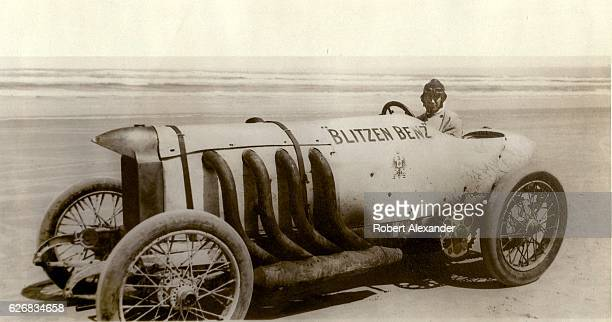 Bob Burman sits behind the wheel of his 'Blitzen Benz' racecar before setting a new land speed record on the hardpacked sand at Daytona Beach Florida