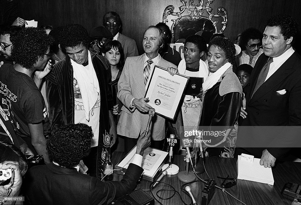 Bob Carr known as Willis the Guard WQXI/94Q (center) along with Atlanta Mayor Maynard Jackson (last on right) present The Recording Academy/Grammy - Atlanta Chapter Special Declaration to The Jacksons on the Triumph Tour at The Omni Coliseum in Atlanta Georgia July 22, 1981