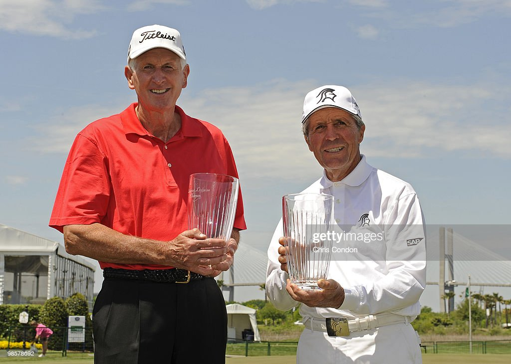 Bob Charles and Gary Player pose with trophies after winning the Demaret Division at the Liberty Mutual Legends of Golf at The Westin Savannah Harbor...