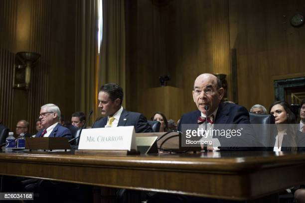 Bob Charrow general counsel of Health and Human Services nominee for US President Donald Trump right speaks as Matthew Bassett assistant secretary of...