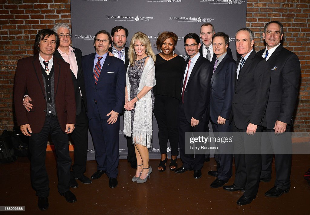 Bob Chiappardi, Bruce Fingeret, Phil Colicchio, Marc Reiter, Laura Heatherly, Robin Quivers, Patrick Mata,Tim Grell, Tom Corson, Doug Ratatori and Christopher Mattioli attend T.J. Martell Foundation's Annual World Tour of Wine Dinner at The Angel Orensanz Foundation on November 14, 2013 in New York City.