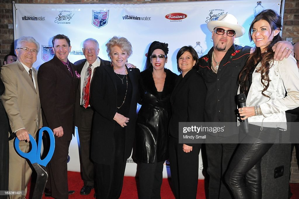 Bob Coffin, <a gi-track='captionPersonalityLinkClicked' href=/galleries/search?phrase=Louis+Prima+Jr.&family=editorial&specificpeople=6312887 ng-click='$event.stopPropagation()'>Louis Prima Jr.</a>, <a gi-track='captionPersonalityLinkClicked' href=/galleries/search?phrase=Oscar+Goodman&family=editorial&specificpeople=646020 ng-click='$event.stopPropagation()'>Oscar Goodman</a>, Las Vegas Mayor Carolyn Goodman, Ava Berman, friend, Big Daddy Carlos and Amy Heart attend the Fremont Country Club opening with <a gi-track='captionPersonalityLinkClicked' href=/galleries/search?phrase=Louis+Prima+Jr.&family=editorial&specificpeople=6312887 ng-click='$event.stopPropagation()'>Louis Prima Jr.</a> and The Witnesses at Fremont Country Club on March 6, 2013 in Las Vegas, Nevada.