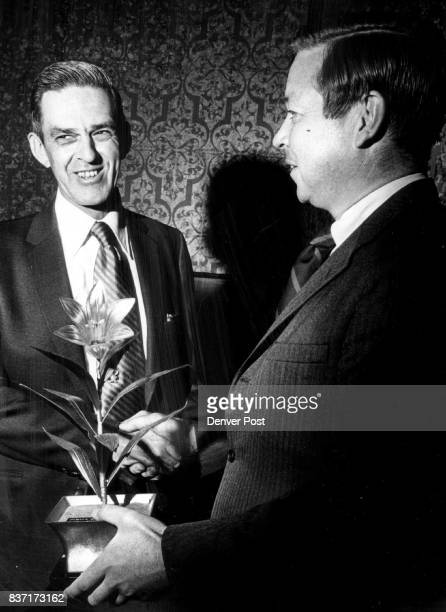 Bob Collins left presents Newspaper Guild's Award at Show Guilded Lily was received by Colorado GOP chairman Bob Flanagan for Ron Ziegler...