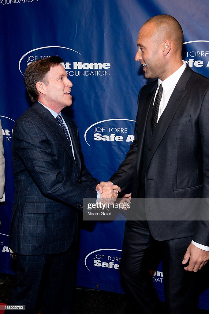 Bob Costas and Derek Jeter attend the 11th Anniversary Joe Torre Safe At Home Foundation Gala at Pier Sixty at Chelsea Piers on November 14, 2013 in New York City.
