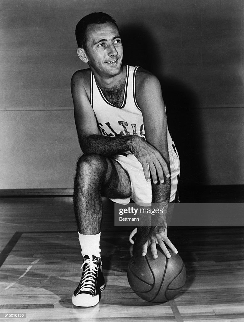 Bob Cousy Posing on Floor With Basketball