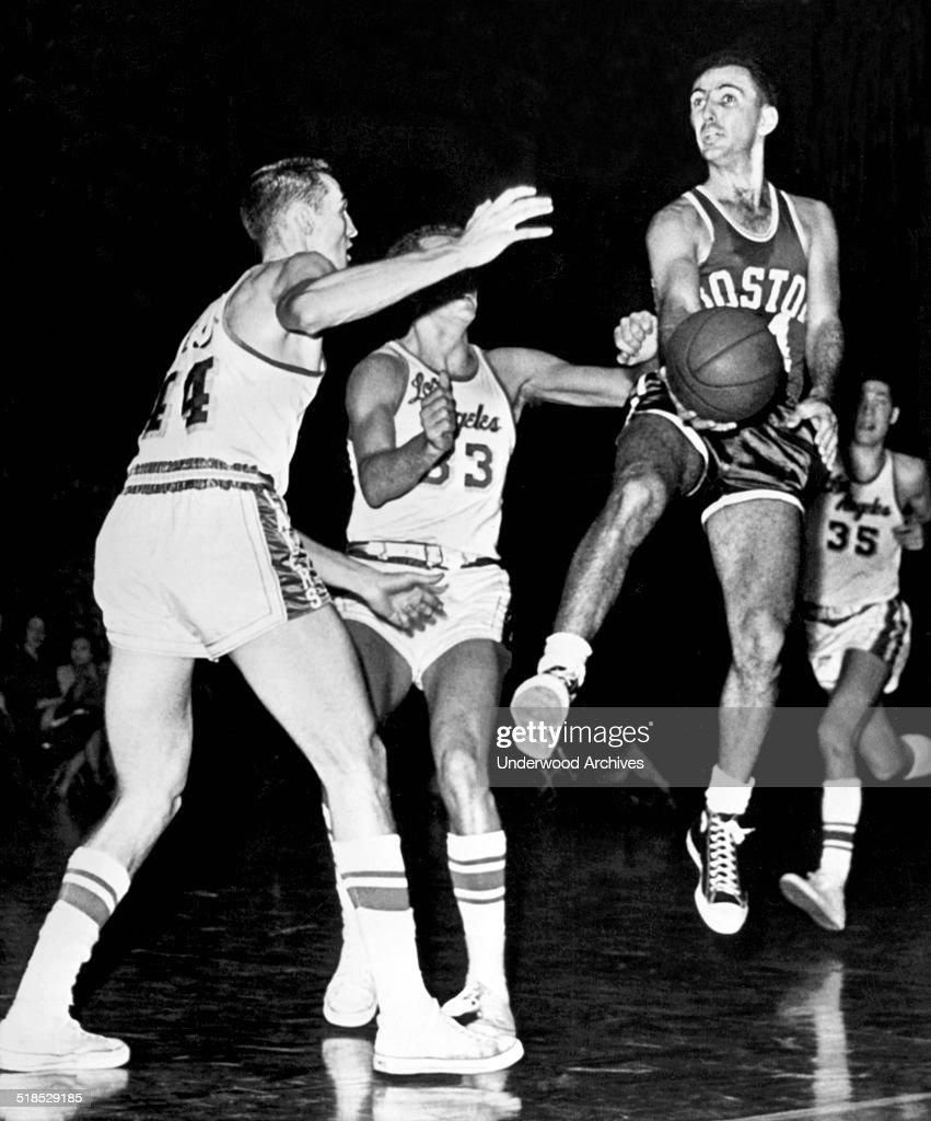 Bob Cousy Passes Basketball